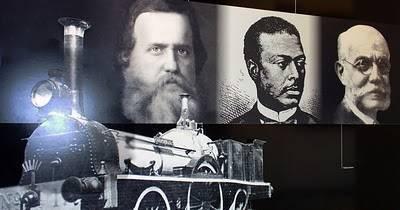 Vemos o eng. Antônio Rebouças ladeado por D. Pedro II e pelo eng. Teixeira Soares.