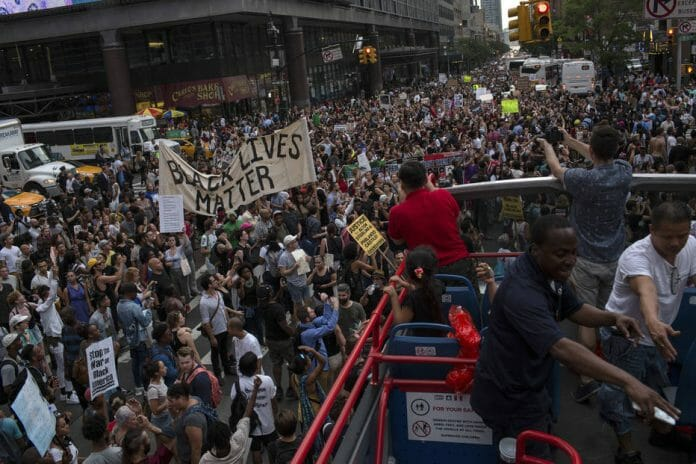 """Protesters angered by two fatal police shootings in two days take to the streets after gathering at Union Square in Manhattan, July 7, 2016. From Warsaw, President Barack Obama described the deaths of Alton Sterling and Philando Castile as symptomatic of racial disparities in the criminal justice system. """"To be concerned about these issues is not political correctness. It's just being an American,"""" Obama said. (Christopher Lee/The New York Times)"""